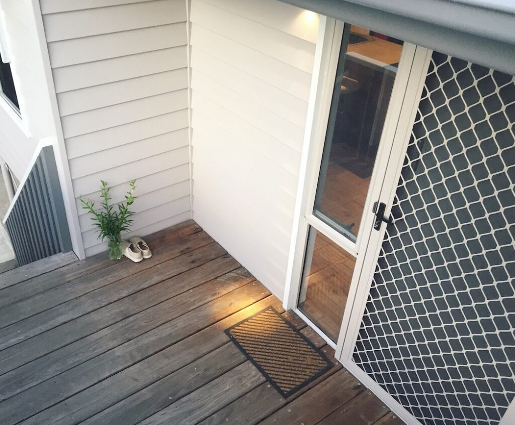 weather board cladding and a recycled front deck