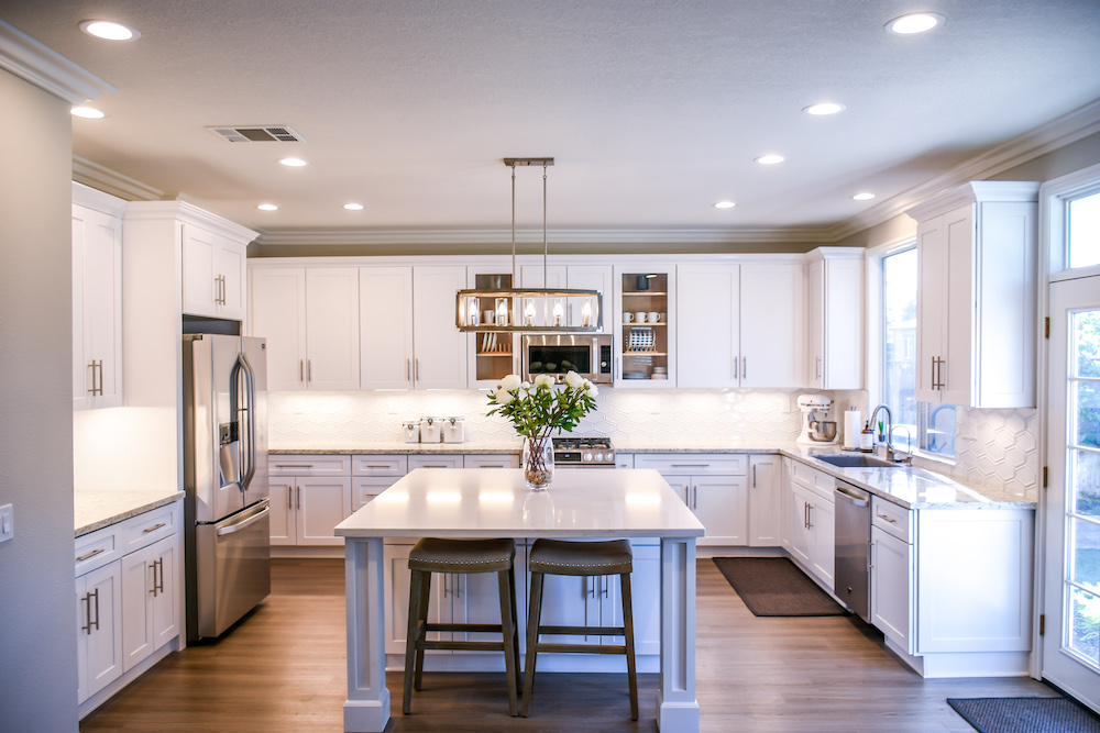 Kitchen with white timber cupboards